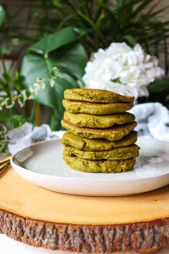 A stack of moringa oatmeal pancakes