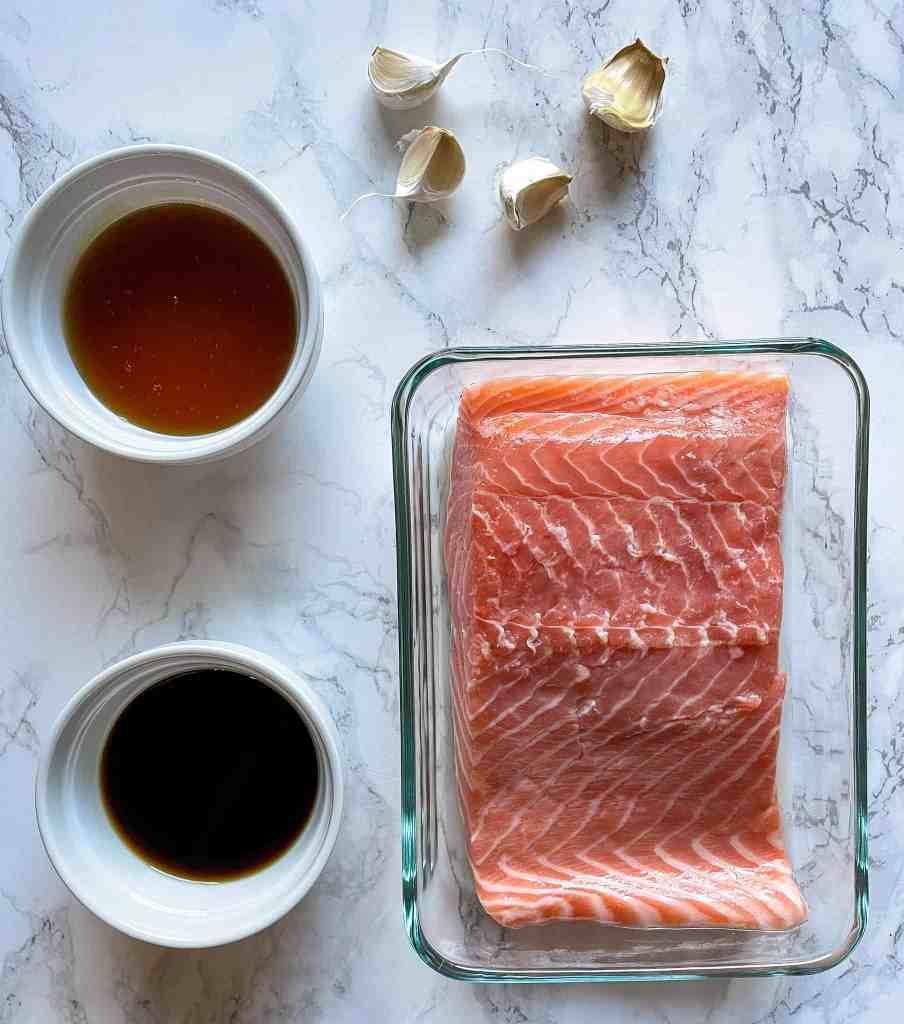 Ingredients to Make Honey Garlic Air Fryer Salmon: Garlic, Honey, Coconut Amino, salt and pepper.