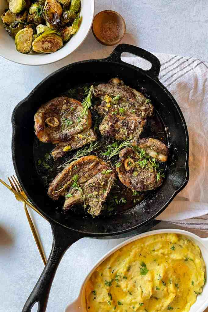 lamb shoulder chops served with brussels sprouts and parsnip mash