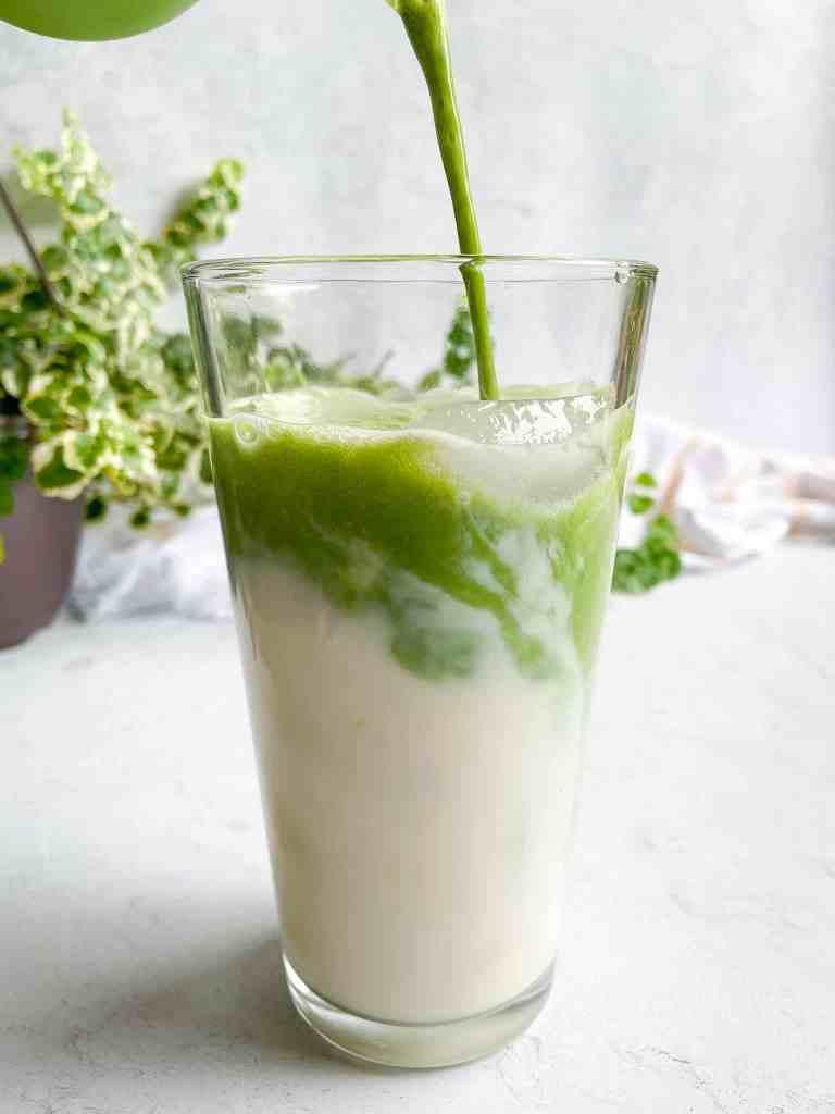 Mixing Matcha With Oat Milk to Make a matcha Latte