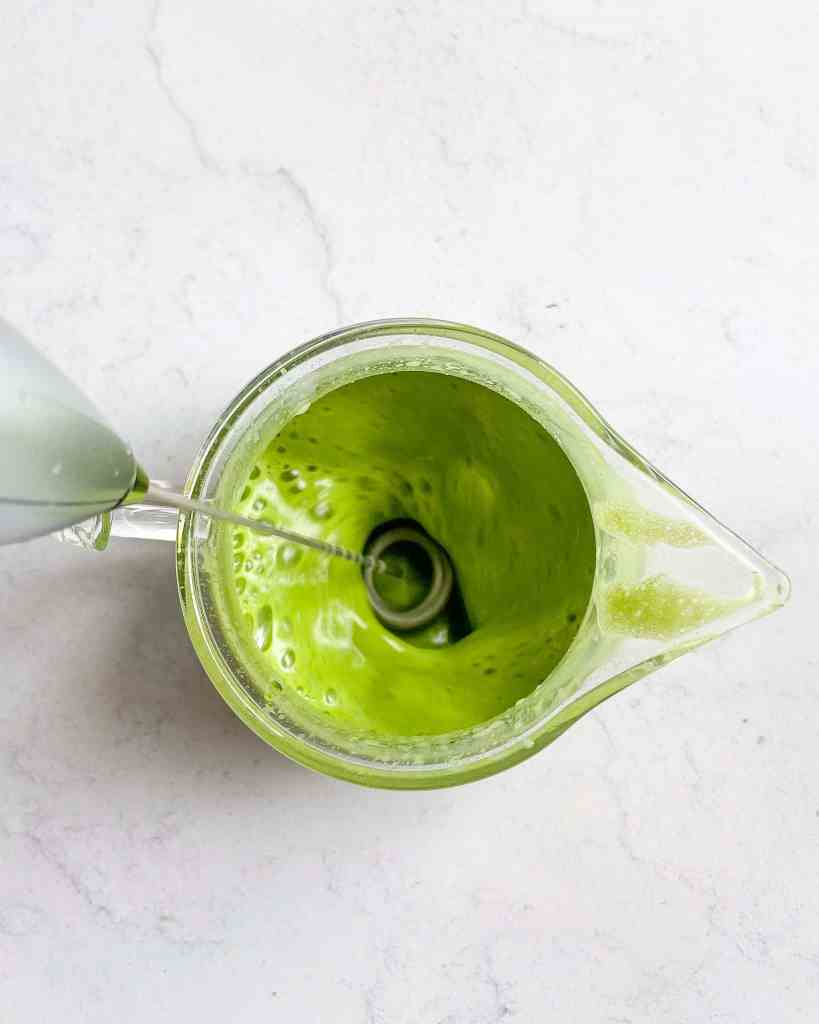 Mixing matcha powder with non-dairy milk or creamer