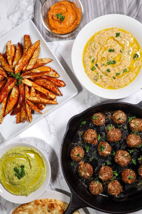 lamb meatballs with eggplant dip almond red pepper dip and cilantro jalapeno hummus