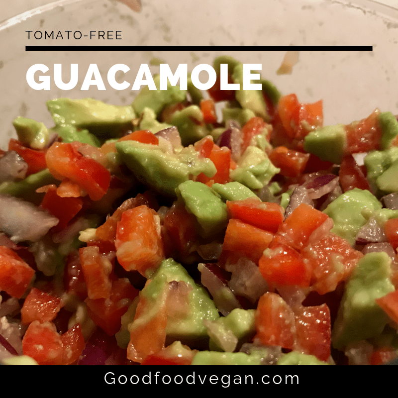 Dish of guacamole salsa with diced avocado, red peppers, and onions. No tomatoes