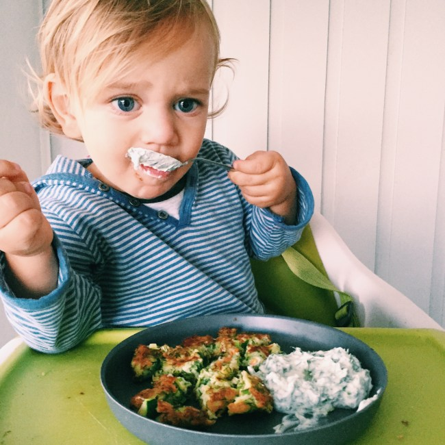 The Little Dude enjoying the zucchini and fetta fritters
