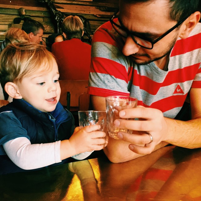 The little dude and Daddy out for Babycinos