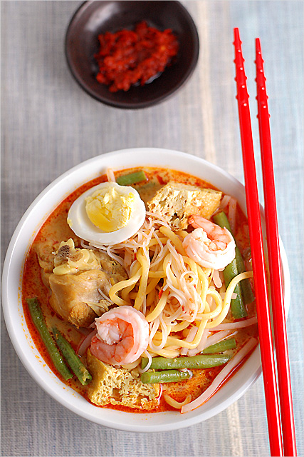 a bowl of Penang Curry Laksa