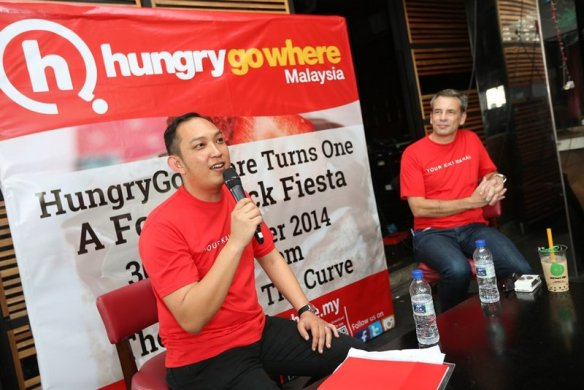 (Left) John Paul Sta Maria. Country Manager of HungryGoWhere and Matt Whittingham, CEO of HungryGoWhere introducing the new and improved website at 'HungryGoWhere Turns One - A Food Truck Fiesta'.