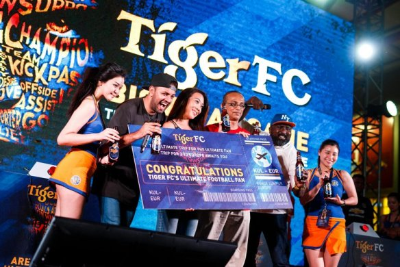 The end of the hunt for The Ultimate Fan as Tiger Beer Marketing Manager Jessie Chuah crowned winner Kumaresan Letchumanahan