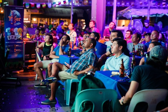 Fans at Tiger Beer's final football viewing party at The Square, Publika