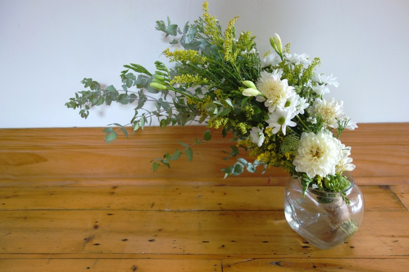 Eucalyptus, golden rod, dahlia, chrysanthemum and freesia bouquet