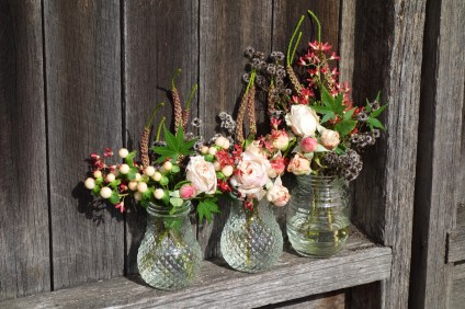 Roses, stirlingia, berries & melaleuca in glass jars