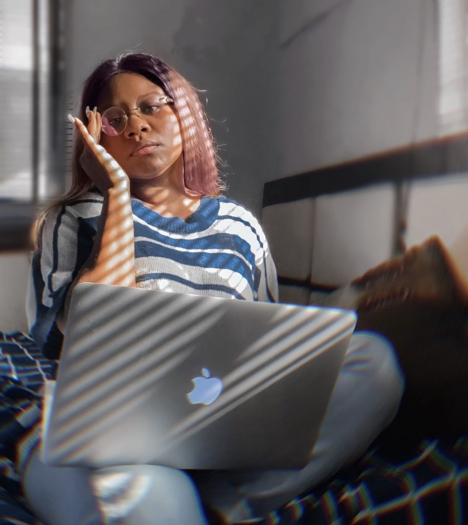 Picture of me holding a laptop - working remotely in Nigeria