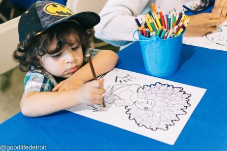 Zechariah colors his coloring sheet.