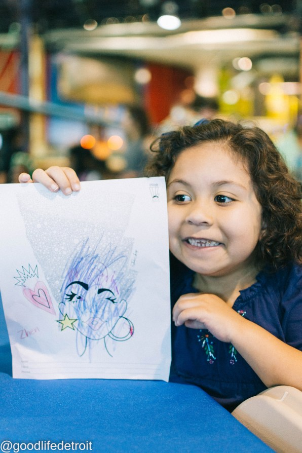 Zhen started off taking her time, but then quickly finished her picture because she was so excited to explore the center. LOL