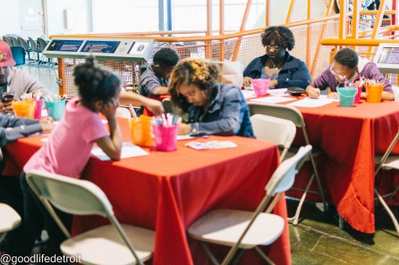Families colored natural hair emoji coloring sheets at the 2017 Youth Day event.