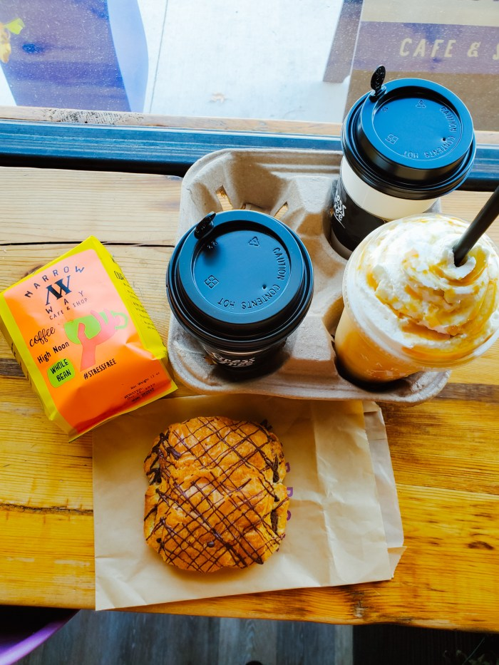Coffee, smoothie, and chocolate croissant at Narrow Way Café in Detroit