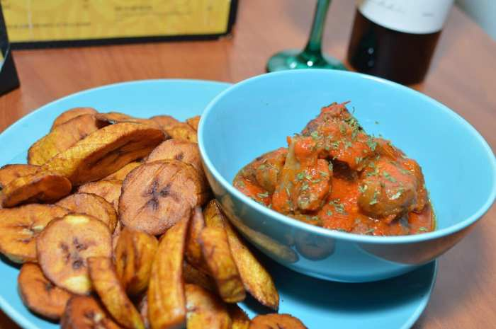 Kola Restaurant and Ultra Lounge in Detroit, Michigan (Photo of cookedplantains and a meat-based West African cuisine.)