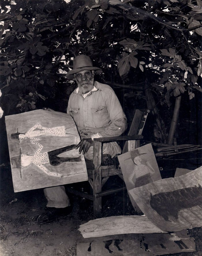 Black artist Bill Traylor is pictured with his artwork. Watch the Bill Traylor: Chasing Ghosts documentary film!