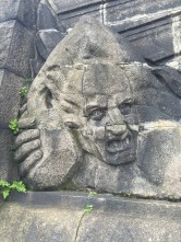 Details along the base of the the statue