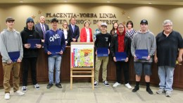 "Mr. Jim Fox (far right) pictured with his El Dorado High School cabinetry students, Trustees, and Dr. Greg Plutko. Mr. Fox was presented the ""You Are The Advantage"" award on February 5, 2019."