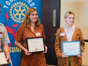 Genevieve O'Gilvy, senior at El Camino celebrate at the YL Rotary Breakfast.