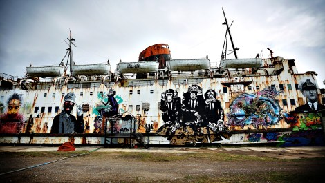 Duke Of Lancaster Graffiti Art Ship...FLINT, WALES - MAY 09: The former cruise ship The Duke of Lancaster sits in it's dry dock adorned with graffiti on May 9, 2013 in Flint, Wales. The ship locally known as the fun ship has been covered with graffiti by international street artists. The art project is organised by a local group named Dudug. Artists have travelled across europe to put their own style of graffiti on the 1950's ship. It is hoped that in the future the ship and it's dock will become a haven for outdoor sculpture and street art. (Photo by Christopher Furlong/Getty Images)