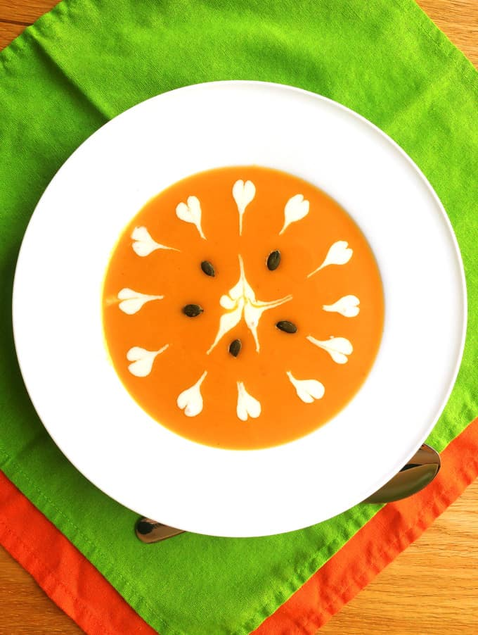 Butternut Squash Soup in a white plate with green and orange napkins