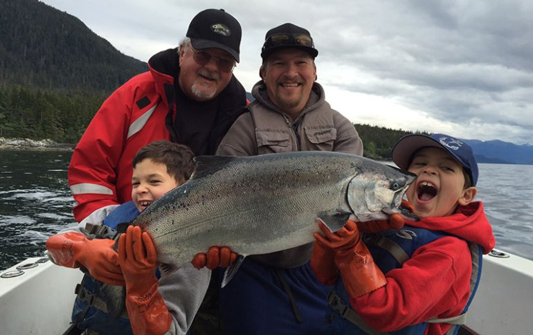 Peterson Family with salmon on a boat