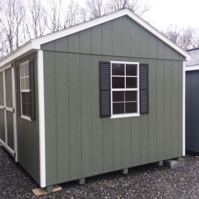 "10 x 12 Painted A-Roof, Avocado Siding, White Trim, Black Shingles and Shutters. 10' Ridgevent, 6' Double Doors and 24"" x 36"" Window Up-Grades. $2,736.89"