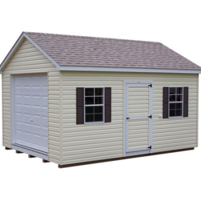 A vinyl shed with a shingled, a-roof style roof. Shed has a garage door at one end, a solid 3 foot wide GGS door, and two windows with shutters