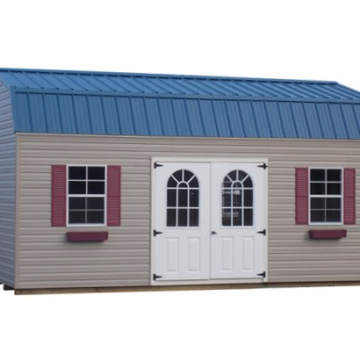 A vinyl shed with a metal, high barn style roof. The shed has a set of optional Fiber 11 Light Doors, and two windows with shutters and flower boxes