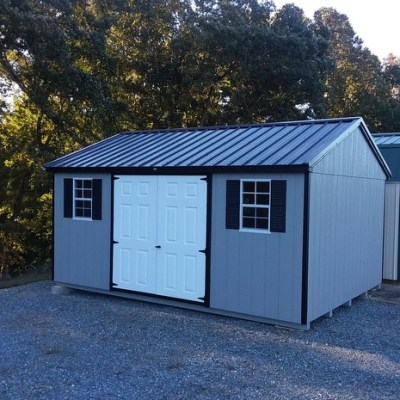 """12 x 16 size painted a-roof style shed with black metal roof and 6 foot fiber double doors with two windows 18"""" x 27"""" , 12' workbench, silver tech smart siding on the walls."""