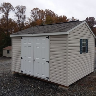10 x 12 size vinyl a-roof style shed with silvermist siding, white trim, driftwood architectural shingle roof, bedford blue shutters, 10' ridge vent and 6 foot fiber doors with two windows
