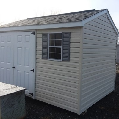 8x12 size a-roof style vinyl shingled shed with 6 foot fiberglass doors and one window on sale lot