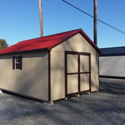 12 x 16 size painted classic style shed with leola almond siding, brown trim, rustic metal roof, brown shutters, 1 8' workbench, l p pro struct flooring, ggs 6 foot doors, two windows and silver tech smart siding.