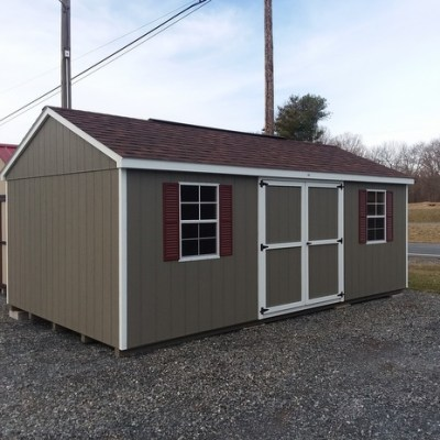 12 x 20 size painted a-roof style shed with clay siding, white trim, brownwood architectural shingle roof, redwood shutters, 1 12' workbench, 10' ridgevent, l p pro struct flooring, ggs 6 foot doors, two windows.