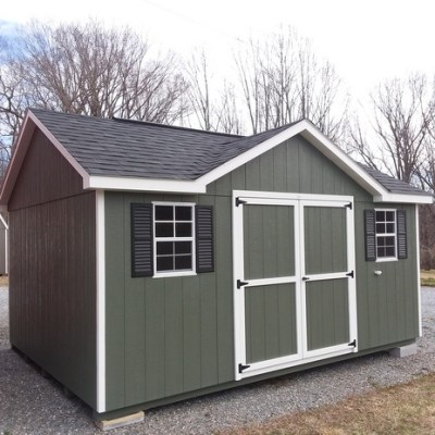 12 x 16 size painted classic dormer style shed with avocado siding, white trim, black architectural shingle roof, black shutters, 1 12' workbench, 10' ridgevent, ggs 6 foot doors, two windows.