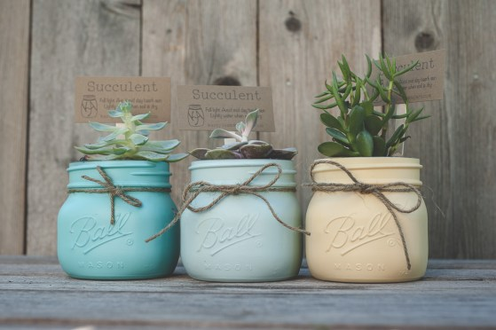 Spray paint mini mason jars and then tie them with twine.
