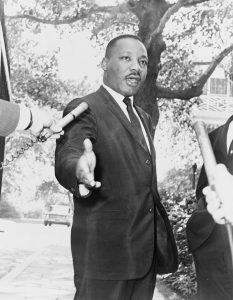 A picture of Martin Luther King, Jr. engaged in public speaking.