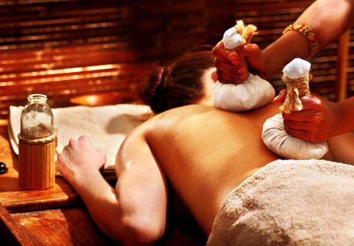 Hot herb poultice massage