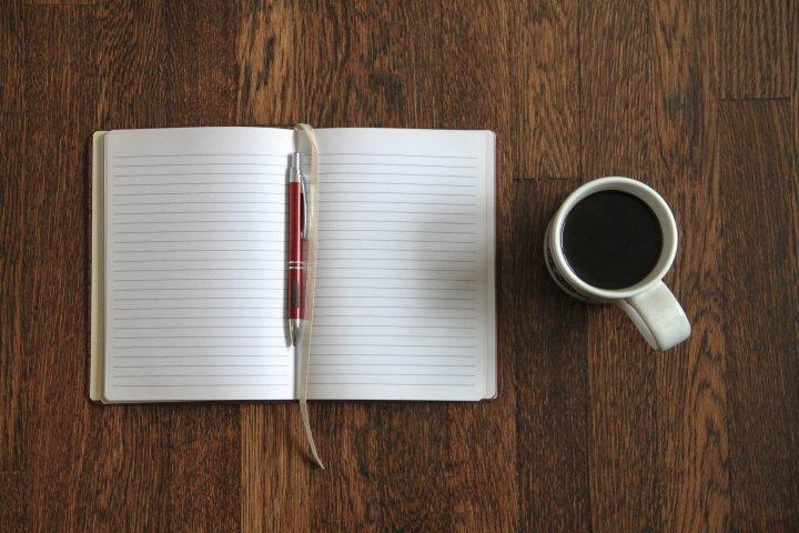 Blank Open Notebook & Coffee on Desk