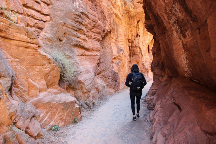 Woman Walking Though Rock Canyon