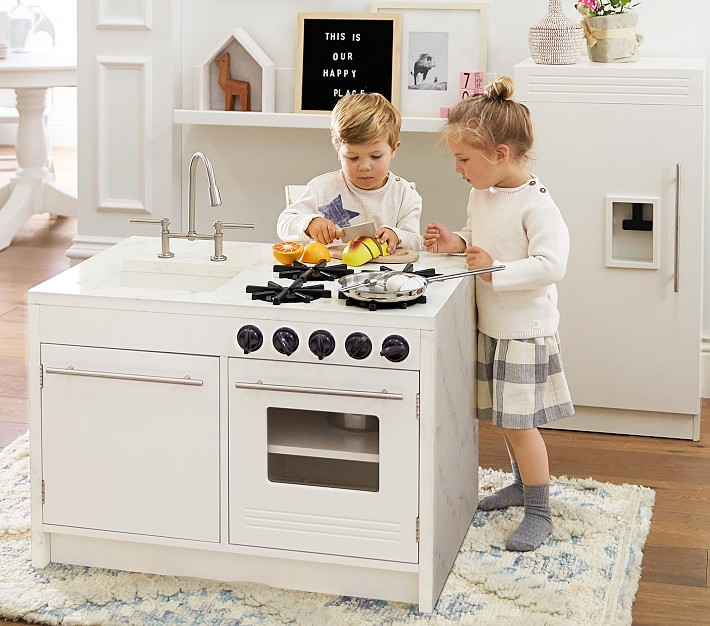 white wooden play kitchens