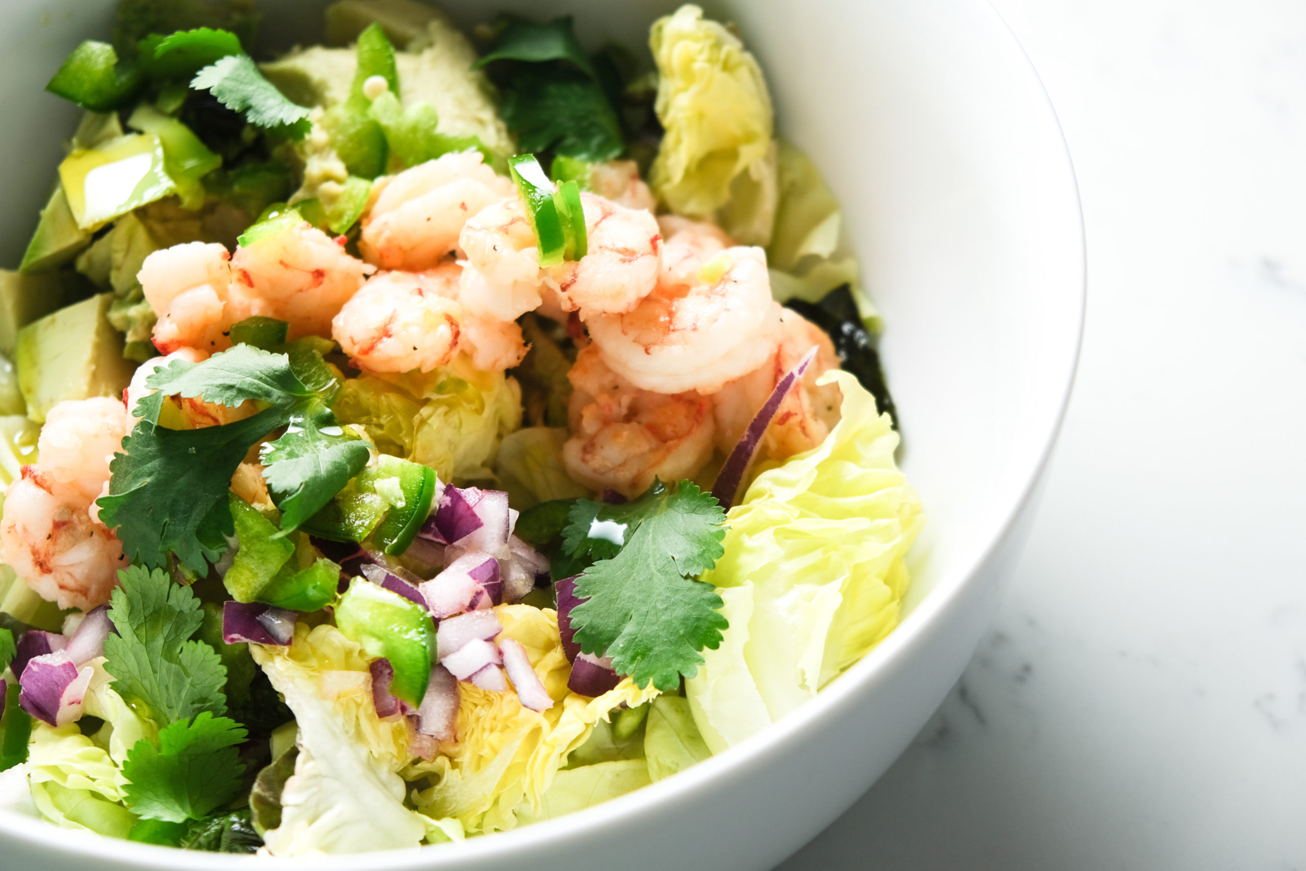 Simple shrimp and avocado salad with lime-marinated red onions