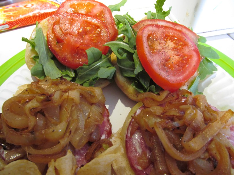 Turkey Canadian bacon grilled cheese with caramelized onions, tomato, and arugula.