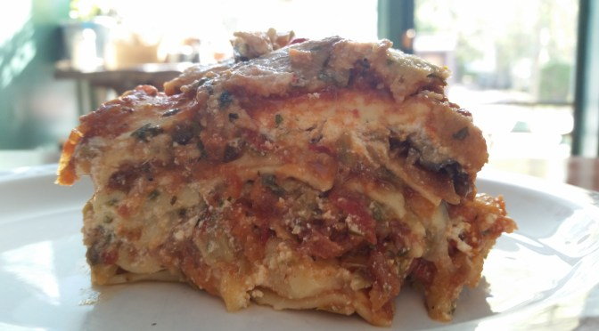 Many Veggie Lasagna has mushrooms, organic local greens, local zucchini, regional peppers, organic onions, and Palatine mozzarella, and can be topped with grass-fed beef meatball crumbles.