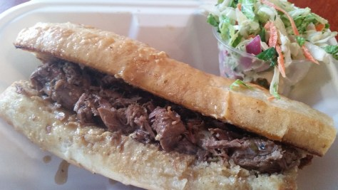 French Dipped Lamb Sandwich: A French-dipped, grass-fed, roasted, Nectar Hills Farm leg of lamb sandwich with fresh house mustard on a Heidelberg baguette, with Nectar Hills Farm Napa cabbage coleslaw.