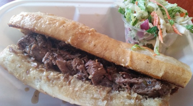 Local, grass-fed lamb sandwich: a Phillipe's-style French-dipped, grass-fed, roasted, Bach Farm (Herkimer) leg of lamb sandwich with fresh house mustard* on a Heidelberg baguette, with broccoli slaw.