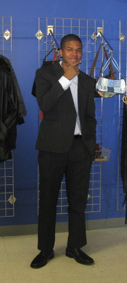 Josh standing in dark grey suit