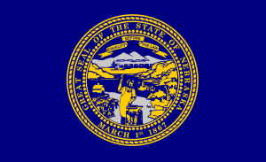 The state flag of Nebraska - deep blue with the state seal in the center.